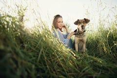 Muchacha hermosa con el perro Imagen de archivo libre de regalías