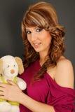 Muchacha hermosa con el perro relleno Imagen de archivo libre de regalías