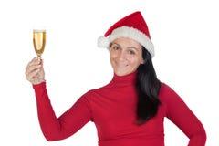 Muchacha hermosa con el sombrero de la Navidad Imagen de archivo