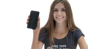 Muchacha hermosa con el teléfono Imágenes de archivo libres de regalías