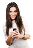 Muchacha hermosa con el teléfono móvil Imágenes de archivo libres de regalías