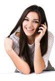 Muchacha hermosa con el teléfono móvil Fotografía de archivo libre de regalías