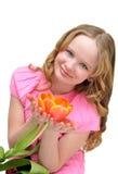Muchacha hermosa con el tulipán de la flor Sonrisa Humor del resorte Imágenes de archivo libres de regalías