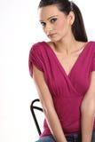 Muchacha hermosa con la alineada rosada Imagen de archivo