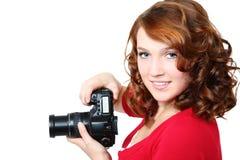 Muchacha hermosa con la cámara Foto de archivo libre de regalías