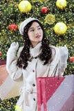 Muchacha hermosa con la decoración de la Navidad Imagen de archivo