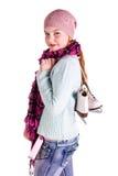 Muchacha hermosa con la figura patines Foto de archivo libre de regalías