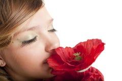 Muchacha hermosa con la flor Imágenes de archivo libres de regalías