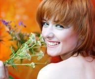 Muchacha hermosa con la hierba fotografía de archivo libre de regalías