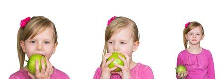 Muchacha hermosa con la manzana verde El concepto de consumición sana, la nutrición de niños Imagenes de archivo