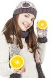 Muchacha hermosa con la naranja Imagenes de archivo