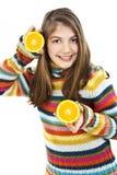 Muchacha hermosa con la naranja Fotos de archivo