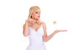 Muchacha hermosa con la varita mágica Fotografía de archivo libre de regalías