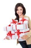 Muchacha hermosa con las cajas de un regalo Imagen de archivo