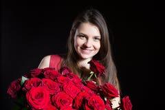 Muchacha hermosa con las rosas Foto de archivo
