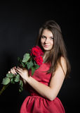 Muchacha hermosa con las rosas Imagen de archivo
