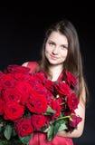 Muchacha hermosa con las rosas Foto de archivo libre de regalías