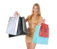 Muchacha hermosa con los bolsos de compras Imagenes de archivo