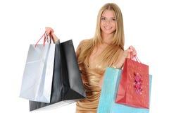 Muchacha hermosa con los bolsos de compras Foto de archivo libre de regalías