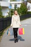 Muchacha hermosa con los bolsos de compras Fotografía de archivo