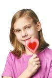 Muchacha hermosa con los corazones de la piruleta Imagenes de archivo
