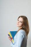 Muchacha hermosa con los libros de textos Fotografía de archivo libre de regalías