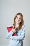 Muchacha hermosa con los libros de textos Fotos de archivo