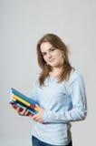 Muchacha hermosa con los libros de textos Imágenes de archivo libres de regalías