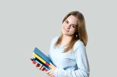 Muchacha hermosa con los libros de textos Fotografía de archivo