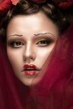 Muchacha hermosa con maquillaje creativo del arte en imagen de la novia roja para Halloween Cara de la belleza Fotos de archivo libres de regalías