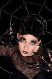 Muchacha hermosa con maquillaje de la araña Fotos de archivo