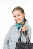Muchacha hermosa con un bolso Foto de archivo