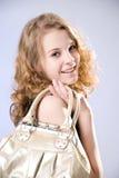 Muchacha hermosa con un bolso Imagen de archivo libre de regalías