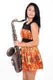 Muchacha hermosa con un instrumento musical Imagen de archivo libre de regalías