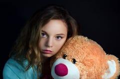 Muchacha hermosa con un juguete Fotos de archivo libres de regalías
