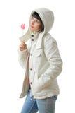 Muchacha hermosa con un lollipop Foto de archivo