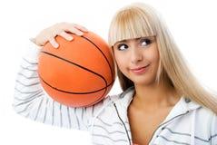 Muchacha hermosa con una bola del béisbol en sus manos Imagen de archivo libre de regalías