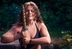 Muchacha hermosa con una espada Foto de archivo libre de regalías