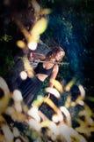 Muchacha hermosa con una espada Imagen de archivo libre de regalías