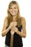 Muchacha hermosa con una guitarra Foto de archivo libre de regalías