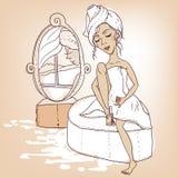 Muchacha hermosa con una toalla en su cabeza Imagenes de archivo