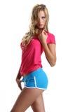 Muchacha hermosa de la moda con pantalones cortos imagen de archivo