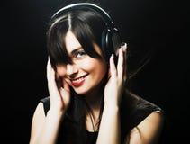 Muchacha hermosa de los auriculares Fotos de archivo