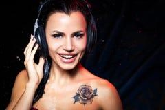 Muchacha hermosa de los auriculares Imagen de archivo