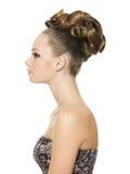 Muchacha hermosa del adolescente con el peinado creativo Imagen de archivo libre de regalías