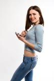 Muchacha hermosa del adolescente con el teléfono móvil Fotografía de archivo libre de regalías