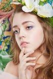 Muchacha hermosa del adolescente con la flor Fotos de archivo libres de regalías