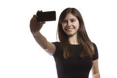 Muchacha hermosa del adolescente que toma un selfie Fotografía de archivo