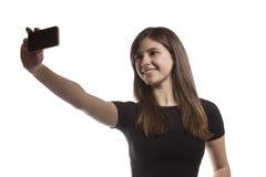 Muchacha hermosa del adolescente que toma un selfie Fotos de archivo