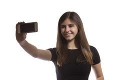 Muchacha hermosa del adolescente que toma un selfie Imagen de archivo
